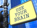 Business concept use your braim roadsign brain on blue background Royalty Free Stock Images