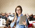 Business conference beautiful woman is speaking on Royalty Free Stock Images