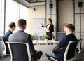 Business conference presentation with team training flipchart office. Royalty Free Stock Photo