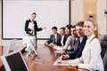 Business consultant answering a question during a meeting at office Royalty Free Stock Photography