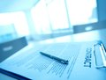 Business contract image of and pen on table Royalty Free Stock Image