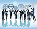 Business cooperation illustration of silhouetted team cooperating with set of interlinking cog wheels Royalty Free Stock Photo