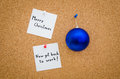 Business corporate christmas greeting card merry but now get back to work written on notes next to a blue globe suggesting the Royalty Free Stock Photo