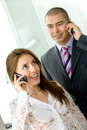 Business couple with cellular Royalty Free Stock Images