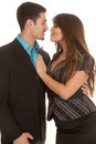 Business couple almost kissing a is standing together and are about to kiss Stock Photography