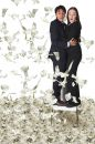 Business couple with lots of money Royalty Free Stock Image