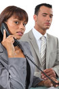 Business couple making a call important Stock Photos