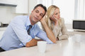 Business couple not talking after an argument in kitchen unhappy the at home Stock Photo