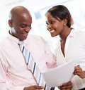 Business couple at the office african american working Royalty Free Stock Image