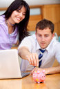 Business couple saving money Stock Image