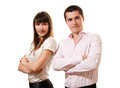 Business couple standing together with folded arms Stock Images