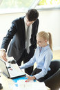 Business couple working on laptop young businesspeople in office shallow focus Stock Photo