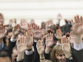 Business crowd raising hands closeup of Royalty Free Stock Photo