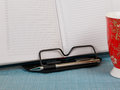 Business diary with pen on bookstand Royalty Free Stock Photo