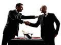 Business dinner handshkes men silhouettes two businessmen dinning handshaking in on white background Royalty Free Stock Photos