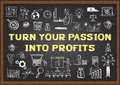 Business doodle with phrase TURN YOUR PASSION INTO PROFITS on chalkboard