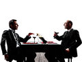 Business drinking wine dinner silhouettes two businessmen dinning in on white background Stock Photo