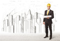 Business Engineer man with building city drawing in background Royalty Free Stock Photo