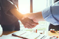 Business engineer team shaking hands to agree to joint business Royalty Free Stock Photo