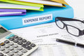 Business expense report with binder financial documents and calculator Stock Photography