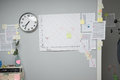 Business failure chart on office wall with paperwork and stick notes Royalty Free Stock Image