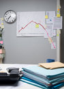 Business failure chart on office wall with paperwork and stick notes Stock Photo