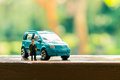Business figure and toy car Royalty Free Stock Photo