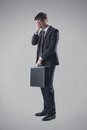 Business and frustration frustrated young businessman covering his eyes Stock Photos