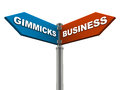 Business gimmicks choose real business frauds gimmicks each word either side signboard Royalty Free Stock Photos