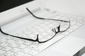Business Glasses on the keyboard Royalty Free Stock Photo