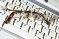 Business glasses on a laptop keyboard Royalty Free Stock Photo