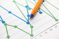 Business graph line graph analysis of financial statements and ballpoint pen close up Royalty Free Stock Photography