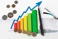 Business graph showing revenue growth coins Royalty Free Stock Image
