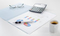 Business graphs with some accessories Royalty Free Stock Photo