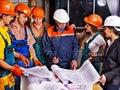 Business group people in builder helmet indoor Stock Images