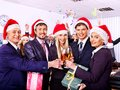 Business group people in santa hat at xmas party happy Stock Photos