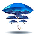 Business group protection and community security concept with a giant blue umbrella metaphor protecting multiple smaller umbrellas Stock Photography