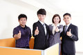 Business group smiles and showing thumb up portrait of happy partners sign in office Royalty Free Stock Images