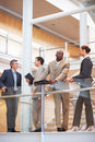 Business group standing by a glass railing Stock Photography