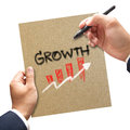 Business hand with pen writing growth on paper concept his Royalty Free Stock Images