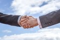 Business handshake for a closing deal closeup of Royalty Free Stock Photo
