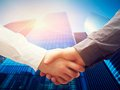 Business handshake skyscrapers background deal success cooperation on modern contract concepts Stock Photography