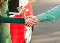 Business handshake to close the deal after buying a car between man and woman Royalty Free Stock Image