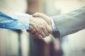 Business handshake. Two businessman shaking hands (Vintage tone)