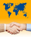 Business handshake under the world Royalty Free Stock Photos
