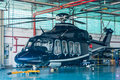 Business helicopter in hangar Royalty Free Stock Photos