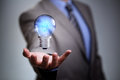 Business idea businessman with illuminated light bulb concept for innovation and inspiration Royalty Free Stock Photos