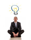 Business idea a young businessman sitting on the floor thinking up new ideas Stock Photo