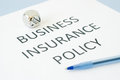 Business insurance policy on blue background Stock Photos