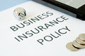Business insurance policy on blue background Royalty Free Stock Photo